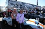 Guests standing beside Ford GT at SEMA 2012