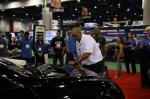 Crowds watch as a car is scrubbed to perfect at 2012 SEMA