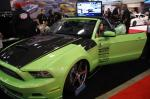 A guest slides into one of SEMA 2012's cars