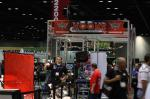 A KOOKS representative explains exhaust technology at the 2012 PRI.