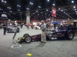 Racing cars claim the floor at the 2012 PRI.