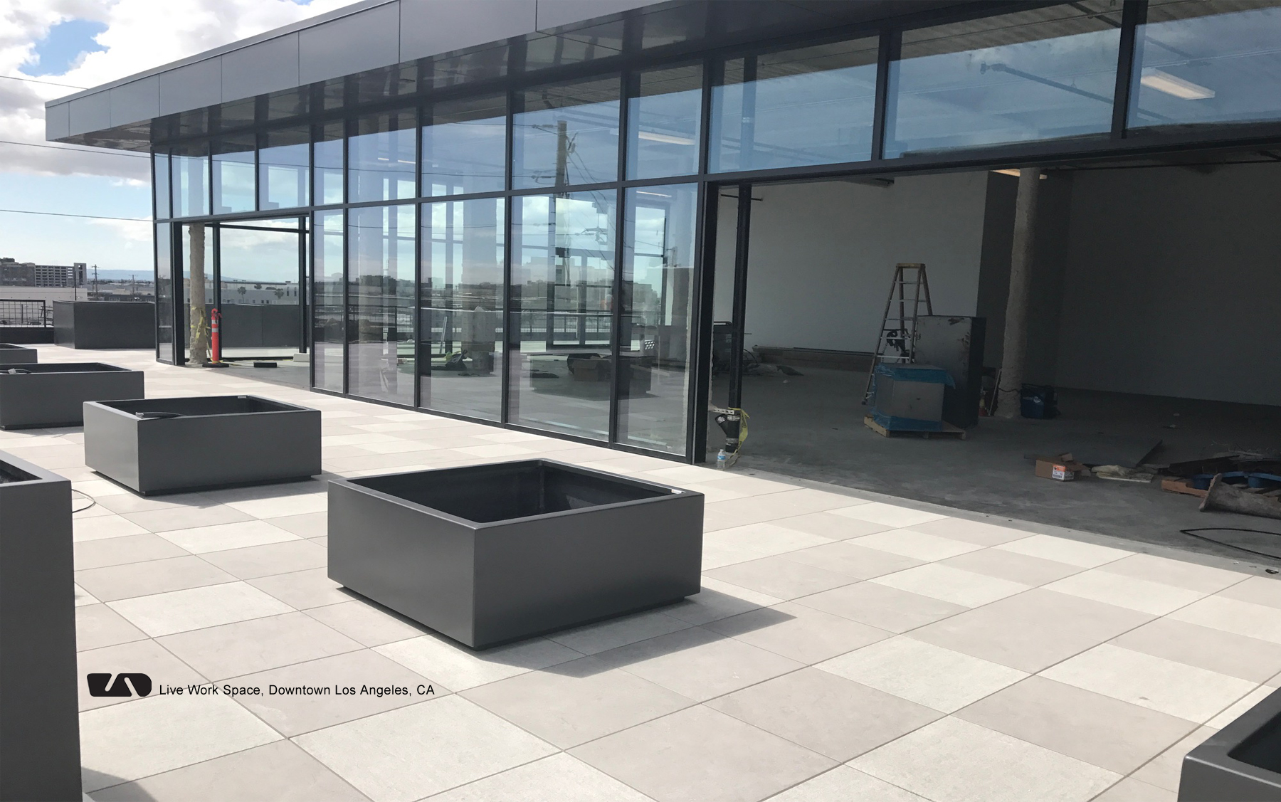 "<h1 class=""text-white"">Pedestal and pavers with lightweight planters make a roof deck functional</h1>"